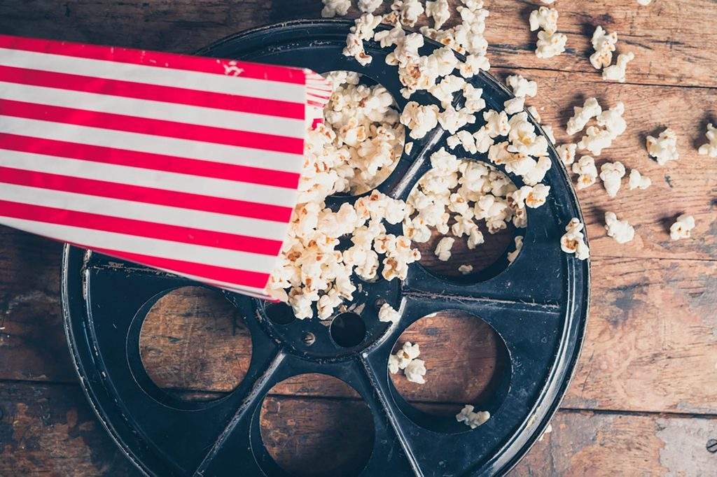 Get-This,-Movie-Theaters-Used-to-BAN-Popcorn—Here's-Why-We-Can-Buy-It-Now-297732923-Lolostock