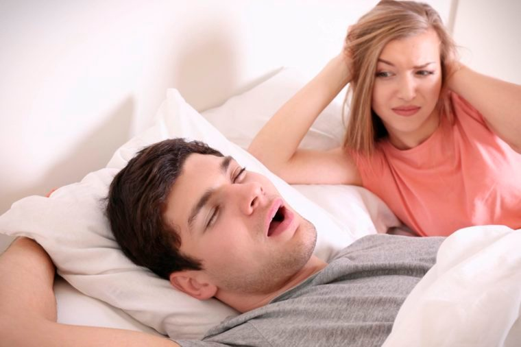 03-snoring-Reasons That Married Couples Should Sleep in Separate Beds_654456553-Africa-Studio